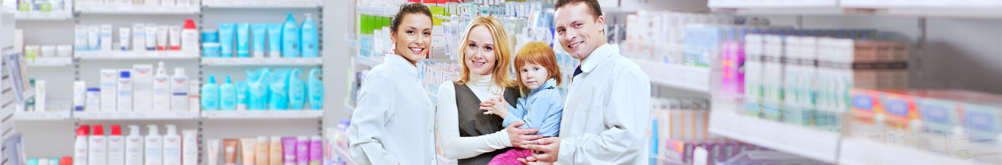 pharmacists and woman carrying her child smiling