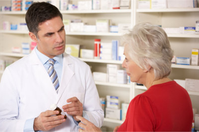 Pharmacist and an elder woman talking